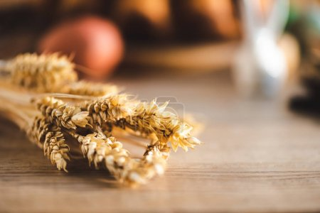 Photo for Selective focus of wheat on wooden table - Royalty Free Image