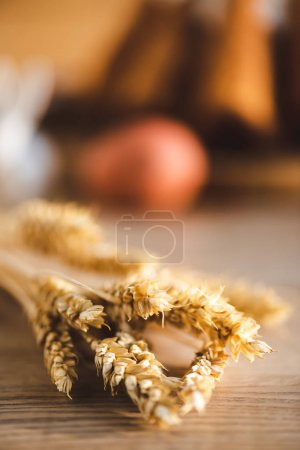 Photo for Selective focus of wheat on wooden desk - Royalty Free Image