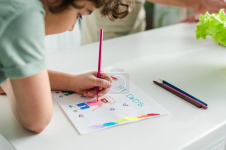 Photo for Selective focus of mixed race kid drawing picture with my dads lettering - Royalty Free Image