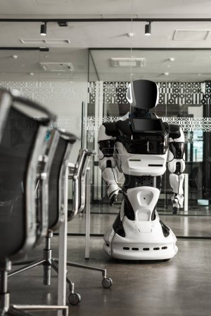 selective focus of humanoid robot standing in conference hall of modern office