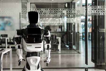 humanoid robot standing in conference hall of modern office