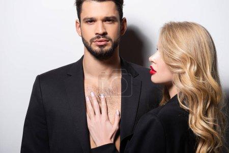Photo pour Attrayant jeune femme regardant bel homme sur blanc - image libre de droit