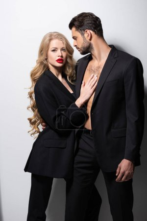 attractive young woman hugging handsome man on white