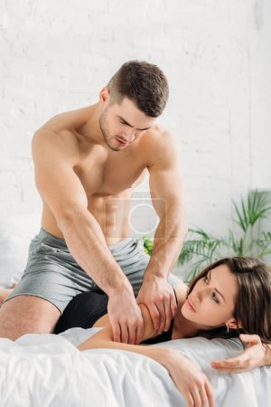 Photo for Handsome shirtless man making arm erotic massage to sexy girlfriend - Royalty Free Image