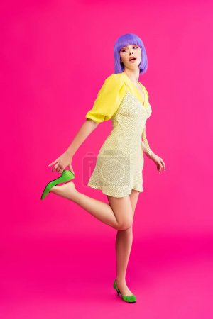 Photo for Attractive pop art girl in purple wig and yellow dress posing on pink - Royalty Free Image