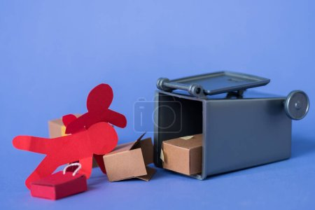 Photo for Paper people near carton boxes and trash can - Royalty Free Image