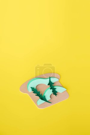 Photo for Top view of paper avocado sandwich isolated on yellow with copy space - Royalty Free Image