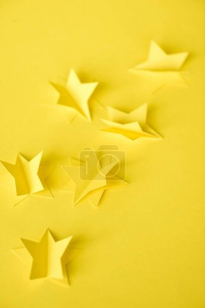 Photo for Selective focus of paper stars on yellow - Royalty Free Image