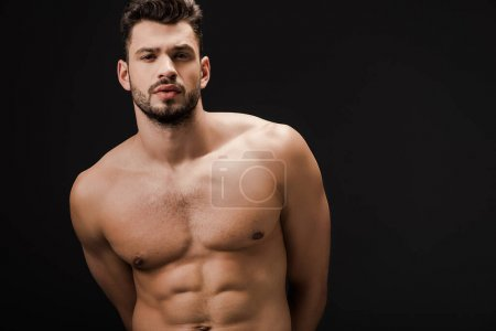 muscular sexy naked man isolated on black