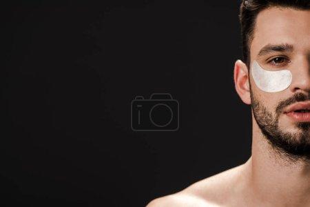 Photo pour Homme sexy avec bandeau sur le visage isolé sur noir avec espace de copie - image libre de droit