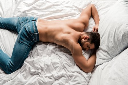 Photo for Top view of shirtless sexy man sleeping on bed - Royalty Free Image