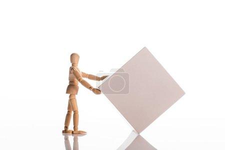 Photo pour Poupée en bois proche carré sur blanc, concept d'évolution - image libre de droit
