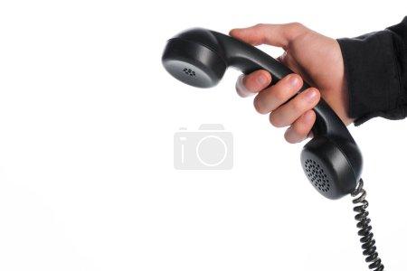 Photo pour Vue recadrée de l'homme tenant le téléphone rétro isolé sur blanc, concept d'évolution - image libre de droit