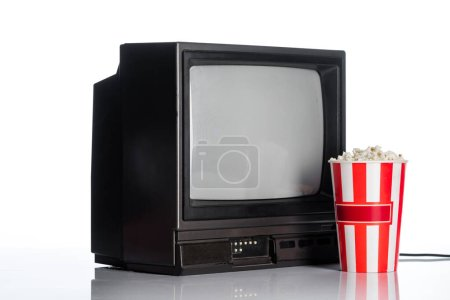 Photo for Bucket with popcorn near vintage tv on white, evolution concept - Royalty Free Image