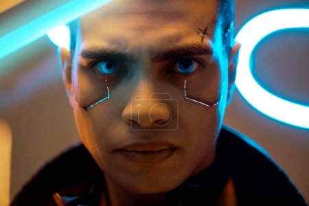 Photo for Bi-racial cyberpunk player with metallic plates on face looking at camera near neon lighting - Royalty Free Image