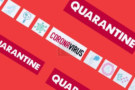 Photo pour Top view of quarantine and coronavirus lettering near drawn medical pictures isolated on red - image libre de droit