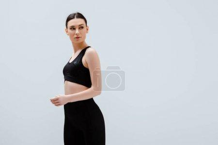 sportive woman in black sportswear isolated on white