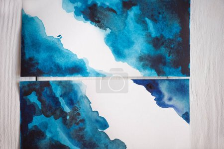 Photo for Top view of paper with Japanese painting with blue watercolor on wooden background - Royalty Free Image