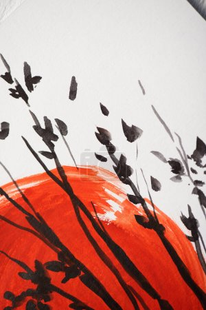 Photo for Top view of paper with Japanese painting with red sun and branches - Royalty Free Image