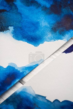 Photo for High angle view of paper with japanese painting with blue watercolor on wooden background - Royalty Free Image