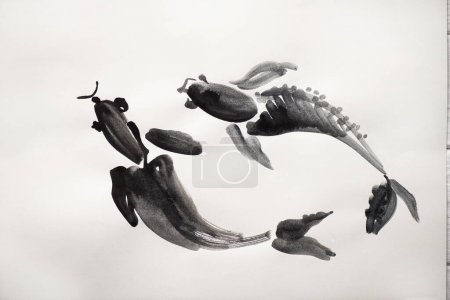 Photo for Top view of paper with japanese painting with fishes on white background - Royalty Free Image