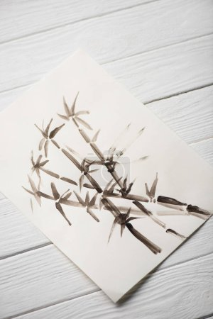 Photo for Top view of picture with japanese painting with bamboo on wooden background - Royalty Free Image