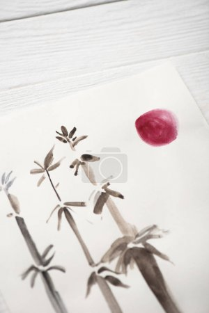 Photo for High angle view of picture with japanese painting with bamboo and pink sun on wooden background - Royalty Free Image