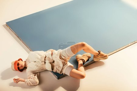 Photo for Stylish model posing for future fashion shoot on beige and blue - Royalty Free Image