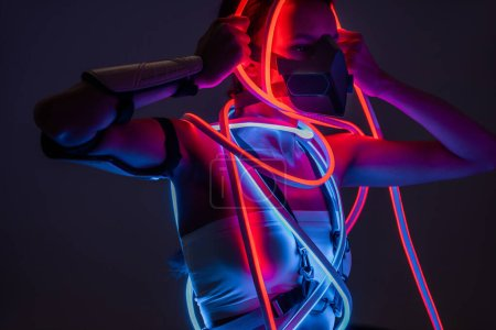 Photo for Futuristic african american woman in respirator and neon lighting - Royalty Free Image