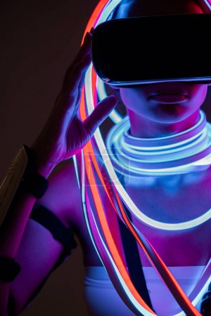 Photo for Futuristic african american woman in vr headset and neon lighting - Royalty Free Image