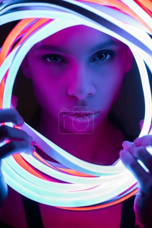 Photo for Portrait of futuristic african american woman in neon lighting - Royalty Free Image