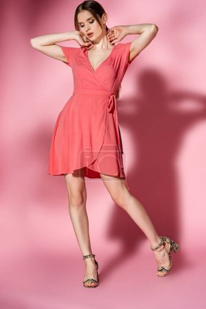 Photo for Stylish girl posing in summer dress and heeled sandals on pink - Royalty Free Image
