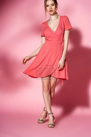 Photo for Fashionable girl posing in summer dress and heeled sandals on pink - Royalty Free Image