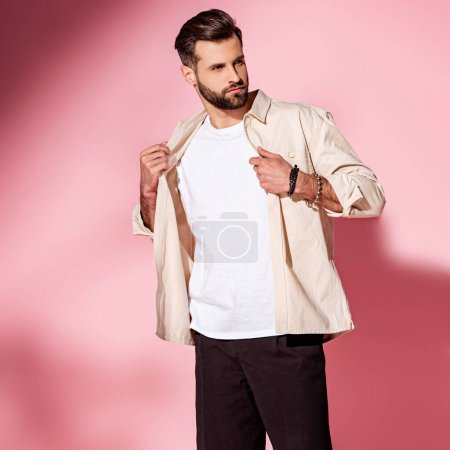 Photo for Fashionable bearded young man posing in summer shirt and shorts on pink - Royalty Free Image