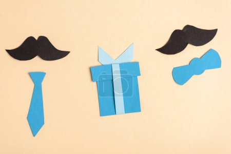 Photo for Top view of paper crafted fake mustache and decorative elements on beige background, fathers day concept - Royalty Free Image