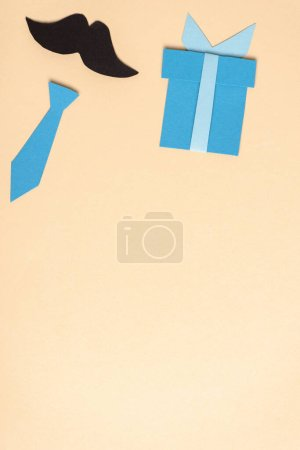 Photo for Top view of decorative paper crafted elements on beige background, fathers day concept - Royalty Free Image