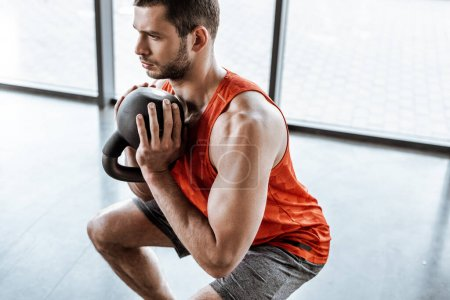Photo for Handsome sportsman doing exercising with heavy dumbbell - Royalty Free Image