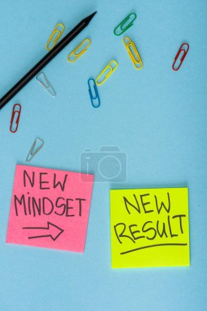Photo for Top view of sticky notes with new mindset and new result lettering with paper clips and pencil on blue - Royalty Free Image