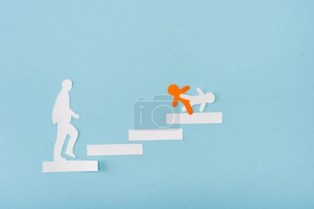 Photo for Top view of paper orange and white men on career ladder on blue - Royalty Free Image