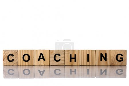 Wooden cubes with coaching lettering on white