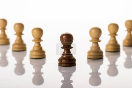 Photo for Selective focus of brown pawn with another on white background - Royalty Free Image