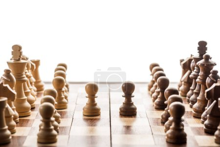 Photo for Selective focus of chess pieces and brown pawn against another on chessboard isolated on white - Royalty Free Image