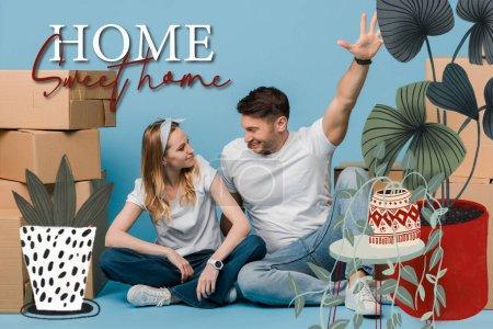 Photo pour Un couple excité assis dans des boîtes en carton pour un déménagement sur une illustration bleue de maison douce - image libre de droit