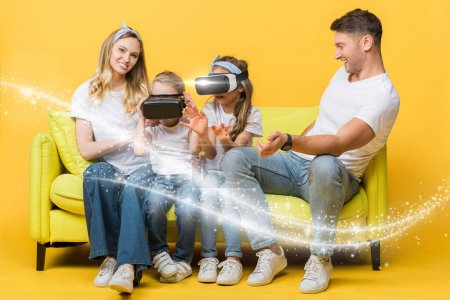 Photo for Happy parents with children in virtual reality headsets sitting on sofa on yellow, glowing illustration - Royalty Free Image