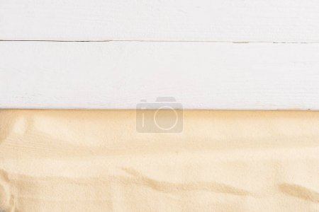 Photo for Top view of white wooden surface and textured sand - Royalty Free Image