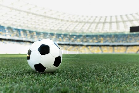 soccer ball on grassy football pitch at stadium