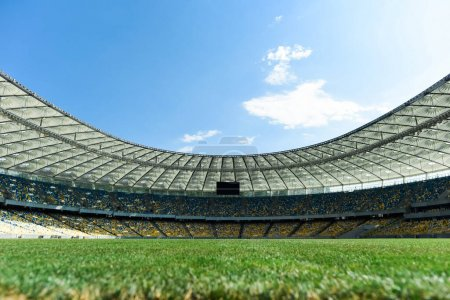 Photo for Grassy football pitch at stadium at sunny day with blue sky - Royalty Free Image