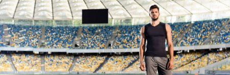 Photo for Handsome young sportsman at stadium, panoramic shot - Royalty Free Image