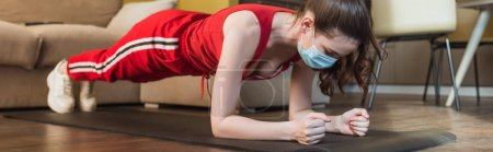 Photo for Panoramic orientation of sportive woman in medical mask and sportswear exercising on fitness mat - Royalty Free Image
