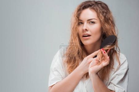 woman combing hair  4
